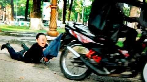 Cướp giật túi xách, kéo lê cô gái hàng chục mét qua ngã tư ở Sài Gòn