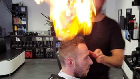 Châm lửa đốt đầu khách để... cắt tóc
