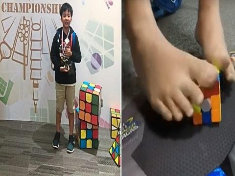Cậu bé 11 tuổi, giải rubik bằng chân nhanh thứ 2 thế giới